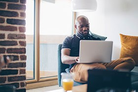 A Man Searching for Tenant Insurance Online