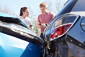 Two Drivers Exchanging Information After Car Accident