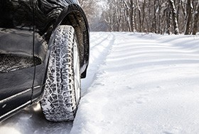 Car Driving With Snow Tires In Winter