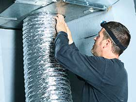 A Workman Fixing a HVAC Unit